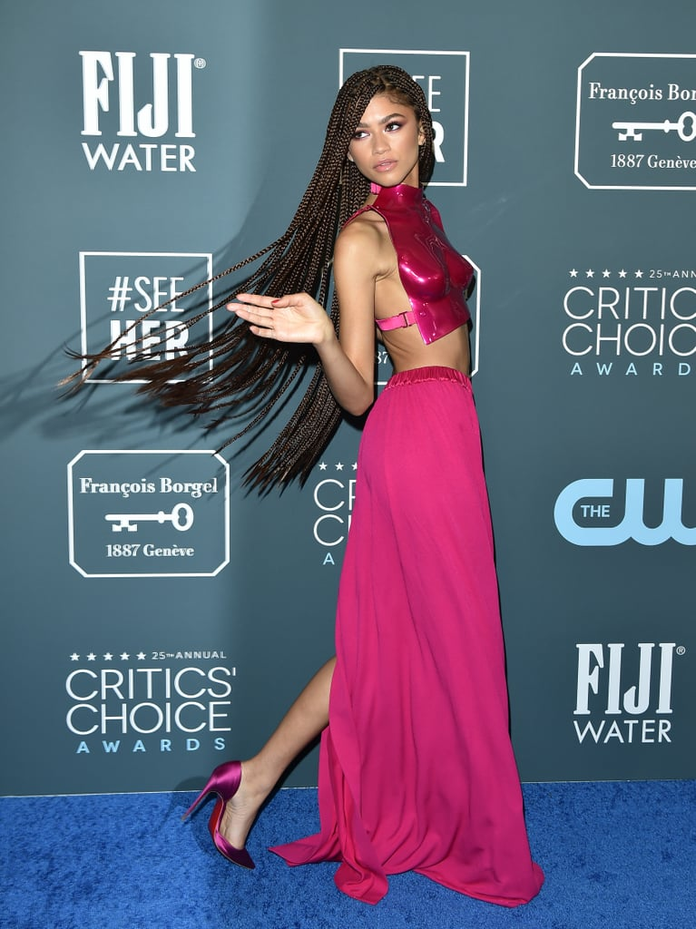 """""""Nothing could hurt me — I was like a warrior,"""" Zendaya said of this hot pink Tom Ford breastplate at the 2020 Critics' Choice Awards, which she styled with Christian Louboutin satin pumps and jewels from Djula and Mateo New York."""