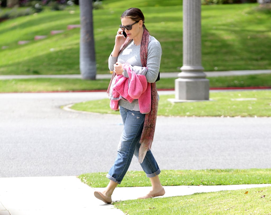 Jennifer Garner carried a pink jacket.
