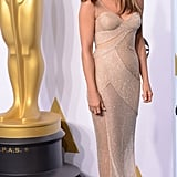 Jen could have easily reused her Oscars gown from earlier this year for her wedding. The sparkly Versace number looked great on her!