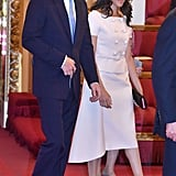 When she attended the Queen's Young Leaders Awards at Buckingham Palace, Meghan wore a gorgeous pink double-breasted dress by Prada.