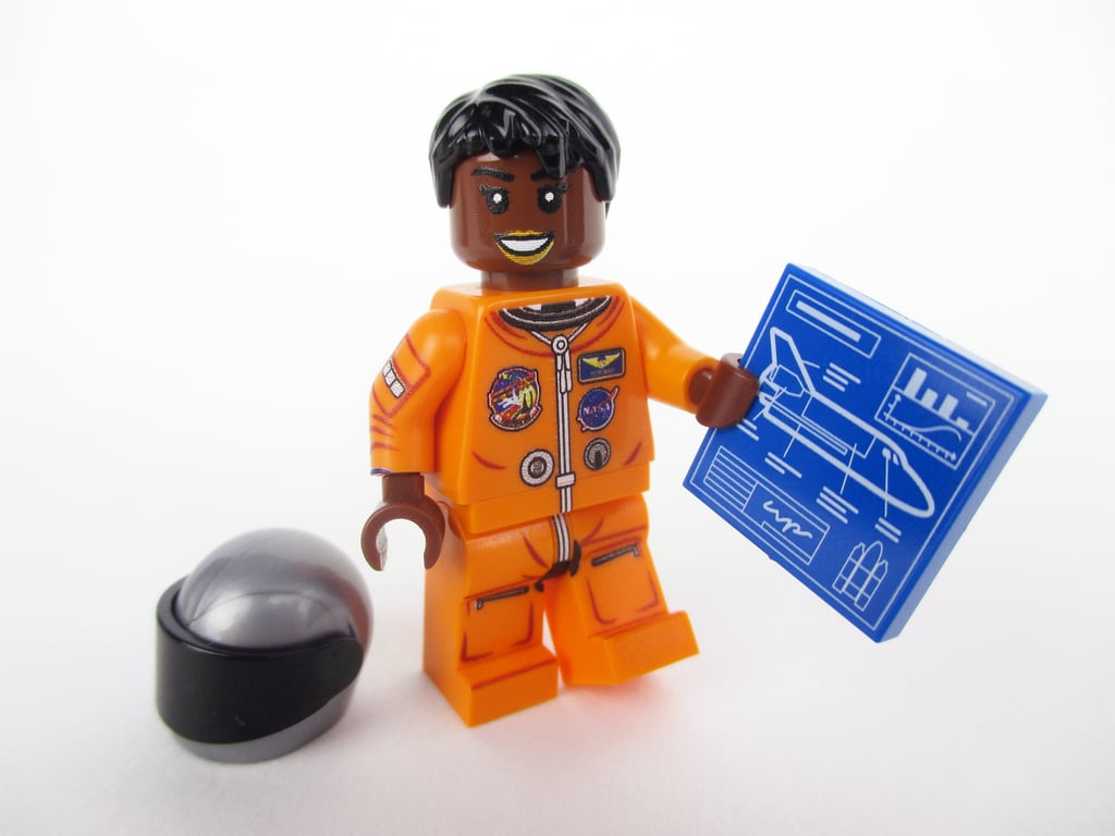Mae Jemison, the first black woman who went to space, holding a diagram of the Space Shuttle.