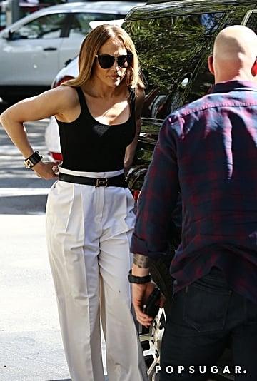 Jennifer Lopez Black Bodysuit and White Trousers