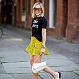 Go quirky-chic and style a printed miniskirt with a graphic tee and fuzzy slides.