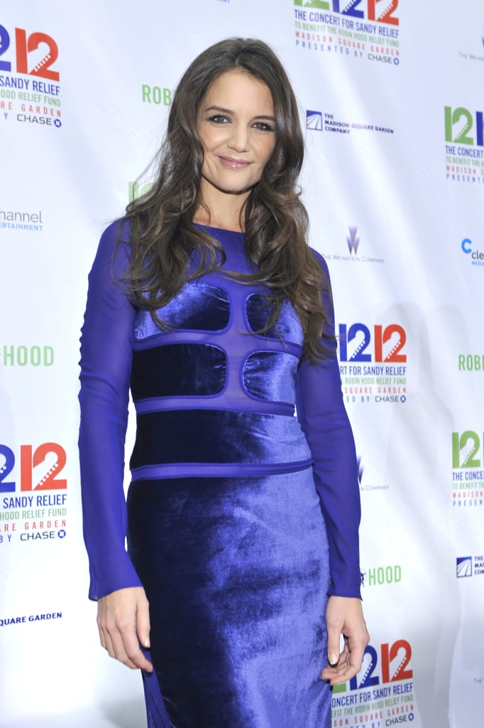 Katie Holmes wore a blue velvet dress at the 12/12/12 concert.