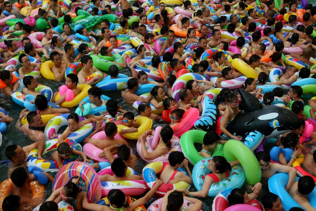 In an attempt to beat record heat, people took to a crowded water park in China.
