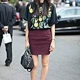 Dress up a cheeky print with a plum-hued pencil skirt and patent leather loafers. Source: Greg Kessler