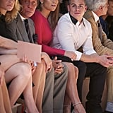 Jennifer Lopez sat next to Valentino during his Paris Fashion Week presentation.