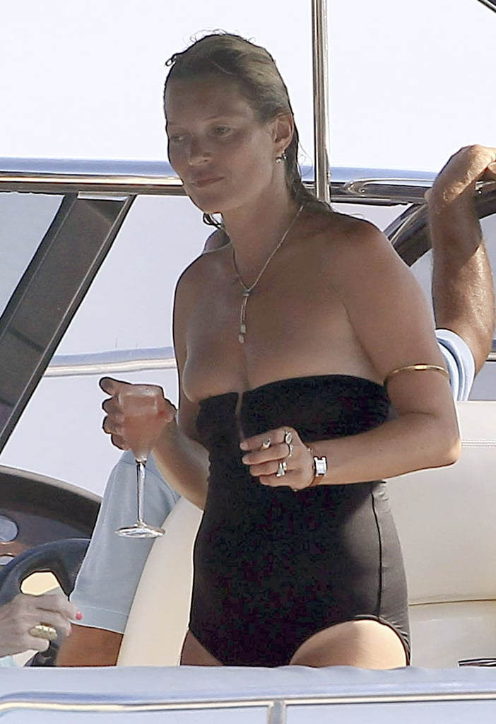 Kate Moss relaxed with a cocktail on board.