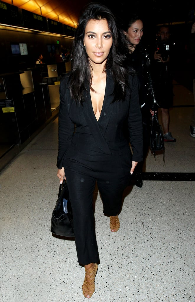 Kim wore a low-cut jumpsuit for her flight; she was spotted departing from LAX on Saturday.