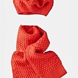 She'll look like a little Francophile in this red Mini Boden Hat and Scarf ($36).