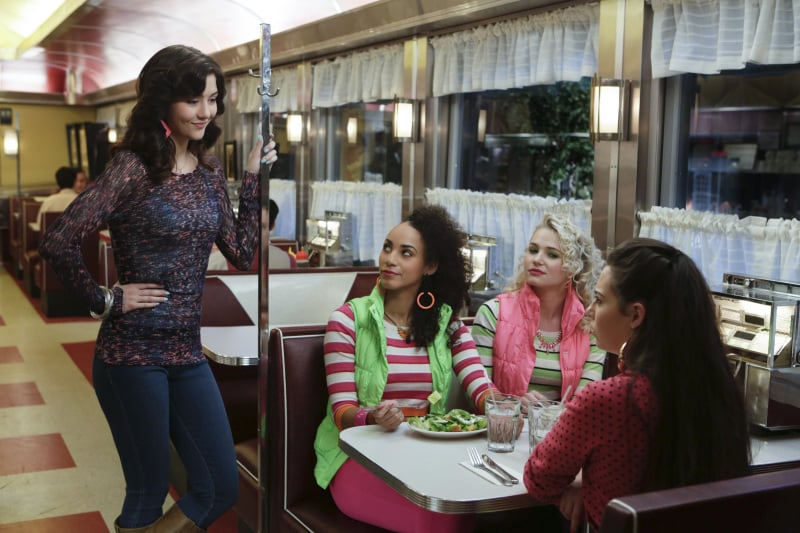 Jen and Jen doubled up on stripes and colourful puffer vests while chatting with Maggie and Chloe at the diner.  Source: The CW