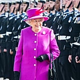 The Queen sported a fuchsia outfit as she visited HMS Ocean in Plymouth on Friday morning.