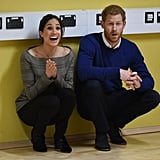 Meghan styled the check-print jacket with black pants and booties, while Prince Harry wore a cashmere Everlane sweater that we'd totally rock on a Winter day.