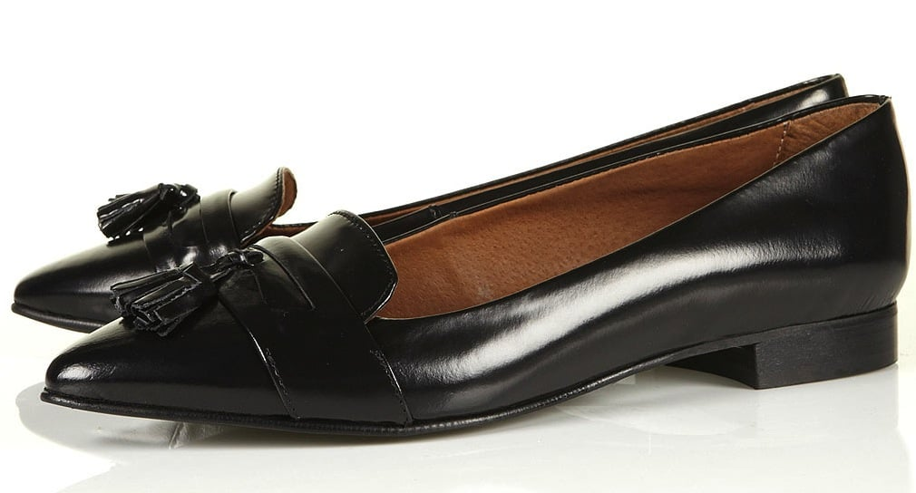 Opt for a classic take on the office-appropriate loafer — but keep it interesting via subtle details. The slightly pointed toe shape, slick tassel accents, and shiny leather make this loafer a cool contender for our Summer work attire. Kutie Pointed Tassel Slippers ($110)