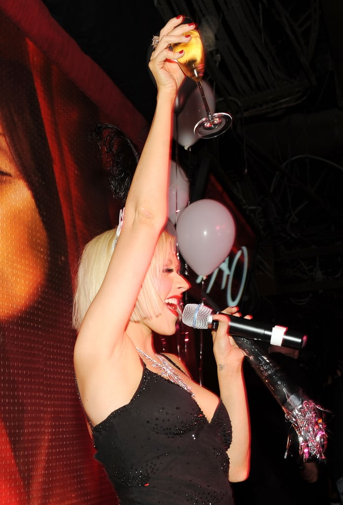 Christina Aguilera raised a glass to the crowd during a 2009 New Year's Eve bash in Las Vegas.