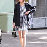 Alexa Chung showed off her signature style out in LA, wearing a gingham minidress with flats and a petite, ladylike bag.
