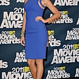 Wearing a Michael Kors dress, Lorraine Schwartz jewelry, and Christian Louboutin shoes to the 2011 MTV Movie Awards.