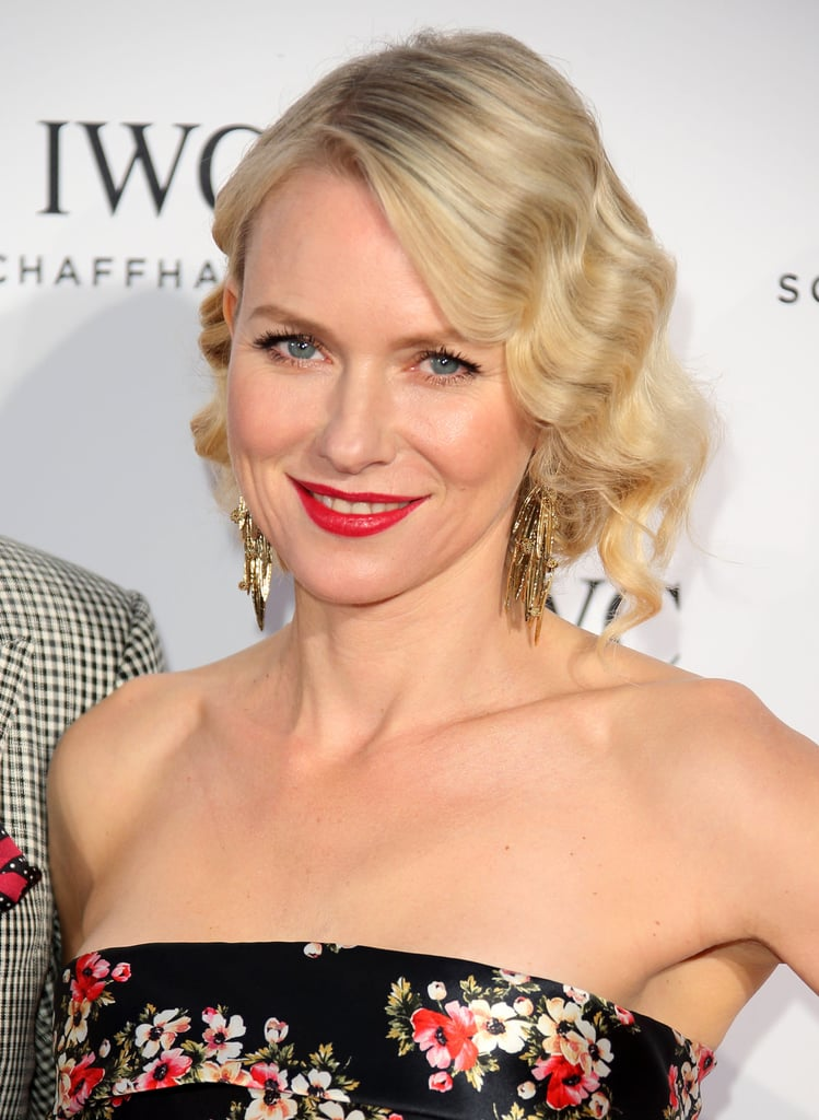 "Naomi Watts was spotted in Cannes working an Old Hollywood glam look of vintage curls with classic red lips. ""For Naomi, I wanted to keep her makeup fresh with a little French influence,"" said makeup artist Georgie Eisdell. To do this, Eisdell created a flawless complexion with Chanel Vitalumiere Aqua Skin Perfecting Makeup ($45) and added a little color and contour to Naomi's face with Bobbi Brown Bronzer in Medium ($38). ""Her lips were the main focus of this look,"" Georgie explained. ""I used Chanel Rouge Allure Velvet Luminous Matte Lip Colour in La Sensuelle ($34) for a gorgeous raspberry pout."""
