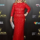 Jacki Weaver wore a red lace dress, cut with a scalloped neckline and long sleeves.