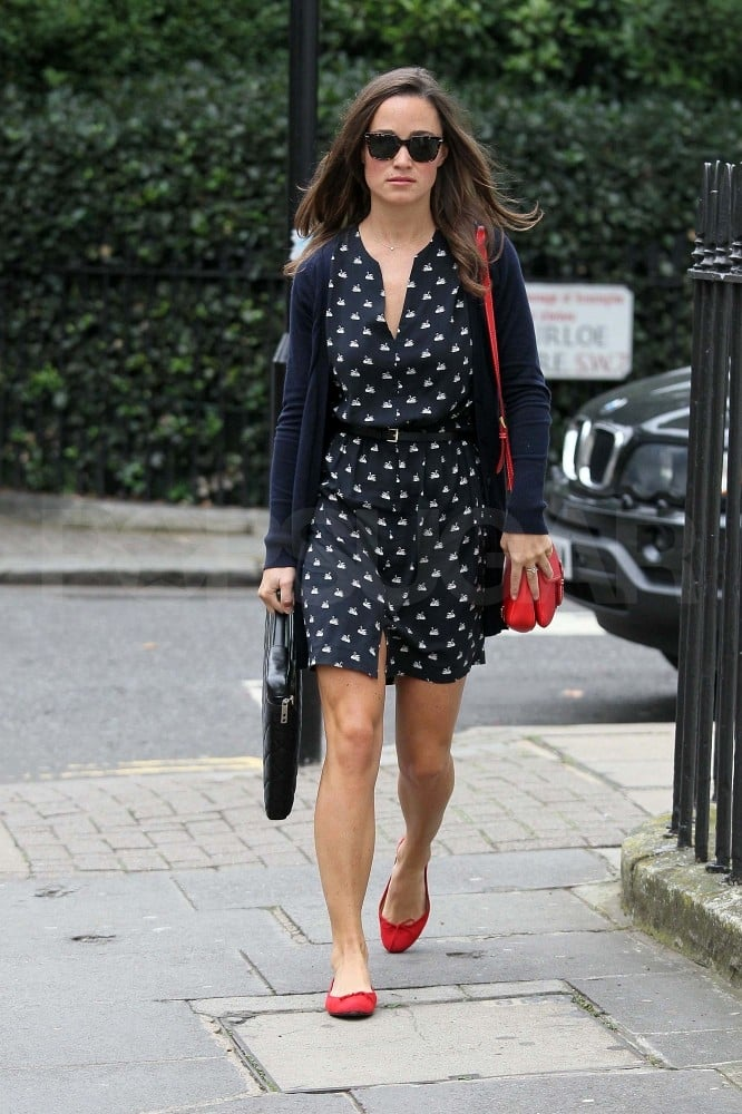 """Pippa Middleton headed to her London office this morning in London in a cute dress. It was just Pippa Middleton's 28th birthday, but the big day hasn't gotten in the way of her work week. The Middleton clan may have more than her milestone to celebrate amid rumors Pippa's big sister, Kate, is pregnant. However, it seems Carole and Michael Middleton won't be grandparents just yet. Palace spokespeople denied Kate's having twins, with a rep saying, """"Suffice to say that were it true, it would be us that announces [a pregnancy]."""""""