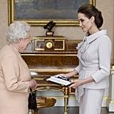 "Angelina Jolie, who is 5'7"", is a head above Queen Elizabeth II."