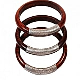 These bracelets are handcrafted from locally sourced woods and leathers by marginalized Muslim women in Northern India. Proceeds from this collection go to fund literacy programs for the women artisans and their children in the community. Ferdoz: Wood & Gunmetal Leather Bangles ($22)