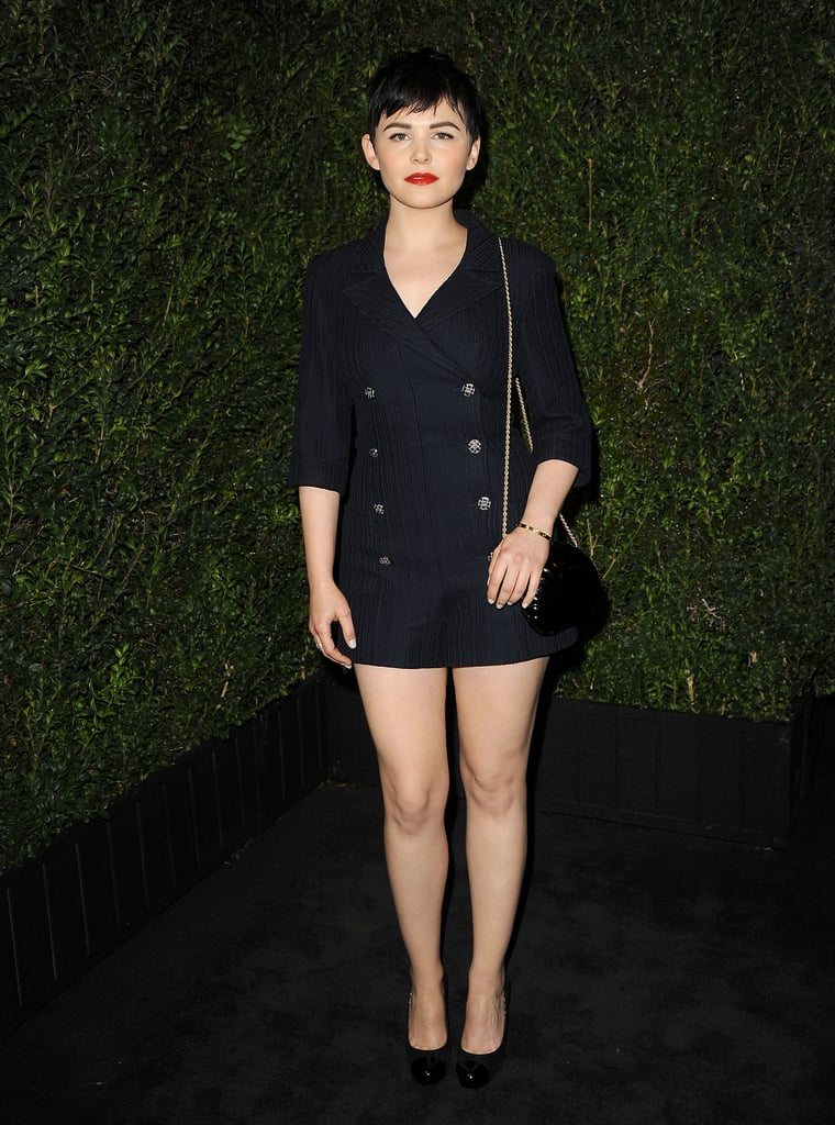 Ginnifer Goodwin evoked a subtle nautical vibe via this navy double-breasted Chanel shorts suit, keeping everything else minimal save for her bold red lip, at the Chanel dinner.