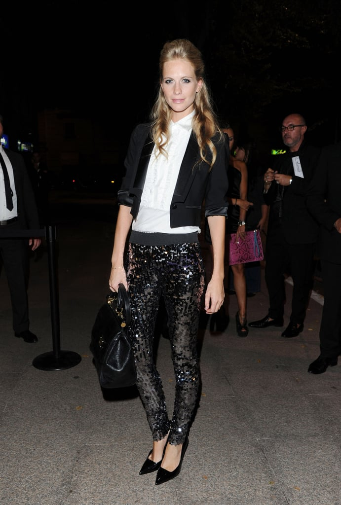 Poppy Delevigne shimmered in sequin leggings, a white top, and cropped black jacket.