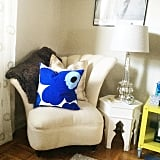 The finds: a bright pillow and a hexagonal end table.
