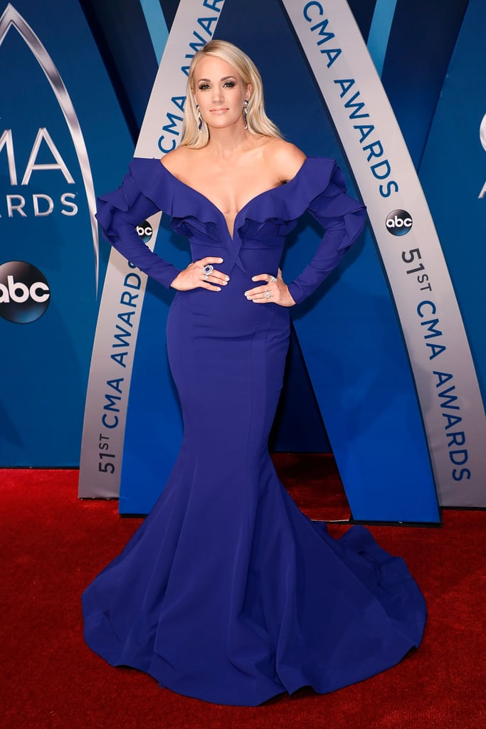 6e4350ada52 Carrie Underwood wore an off-the-shoulder royal blue Fouad Sarkis Couture  dress