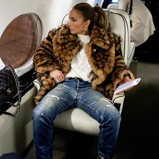 Jennifer Lopez's Coach Logo Coat on the Plane to New York