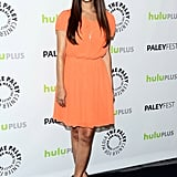 Hannah Simone went for an orange look.