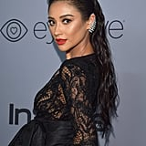 Shay's hair was styled by Andrew Fitzsimons using Alterna Haircare for a long, wet-look finish.