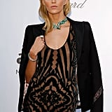 Anja Rubik wore an ultrasheer gown with an emerald-infused collar necklace. To finish her sexy look, she added a slick black blazer.