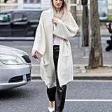 A Long Cream-Colored Cardigan, Leather Trousers, and Heels