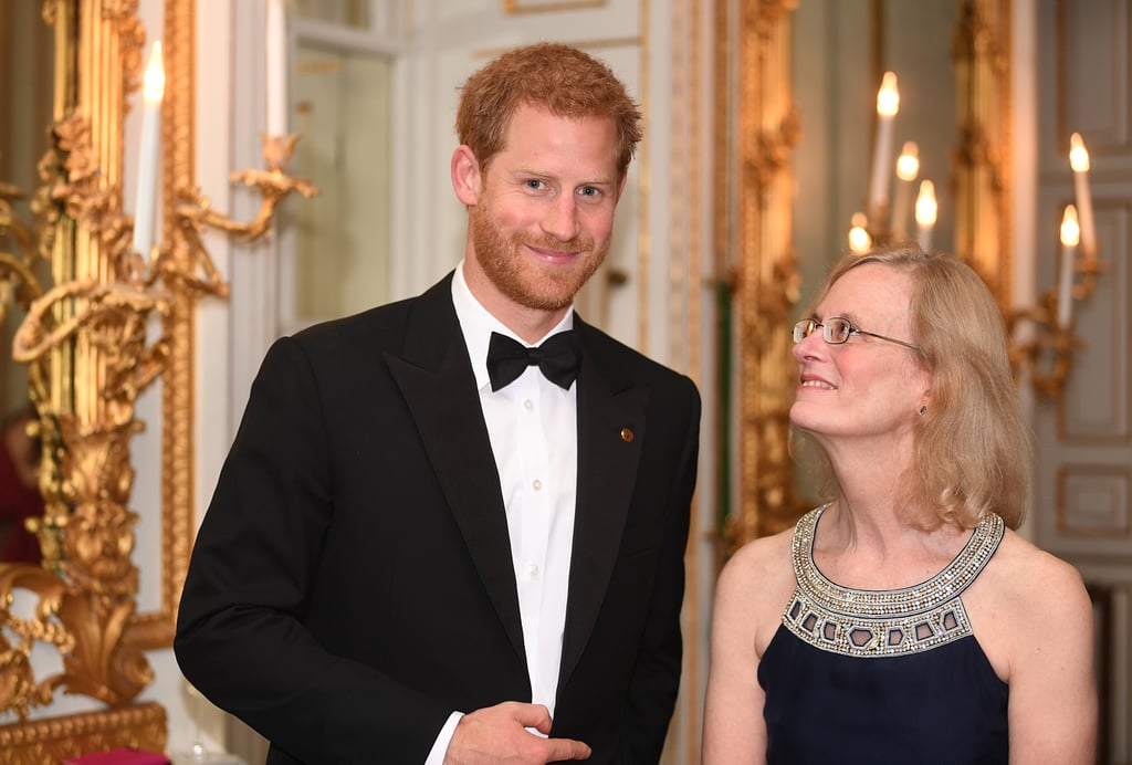 "Prince Harry looked all sorts of dashing when he stepped out for the annual 100 Women in Finance Gala, benefiting the WellChild charity, at London's Victoria and Albert Museum on Wednesday night. Dressed in a black tux and matching bow tie, Harry was surrounded by women as he delivered a speech on behalf of the charity, of which he is a patron. ""I have met the very children and young people for whom WellChild really does change their lives,"" Harry told the crowd as he thanked them for ""making a difference to the lives of hundreds of children and young people."" ""I know the support will once again have a deep impact on the charity."" Harry's latest appearance comes amid reports that he and Meghan Markle have ""already quietly"" gotten engaged. A friend close to the couple reportedly told Us Weekly that Meghan and Harry are ""holding the news back until she has finished on Suits,"" but another insider recently told the publication that they'll be announcing it very soon. We haven't seen a sparkler on Meghan's finger yet, but Harry sure has been looking really happy these days."