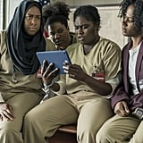 What could Taystee (Danielle Brooks), Cindy (Adrienne C. Moore), Janae (Vicky Jeudy), and Alison (Amanda Stephen) be looking at on that iPad? Judging by Taystee's reaction, it's not a cat video.