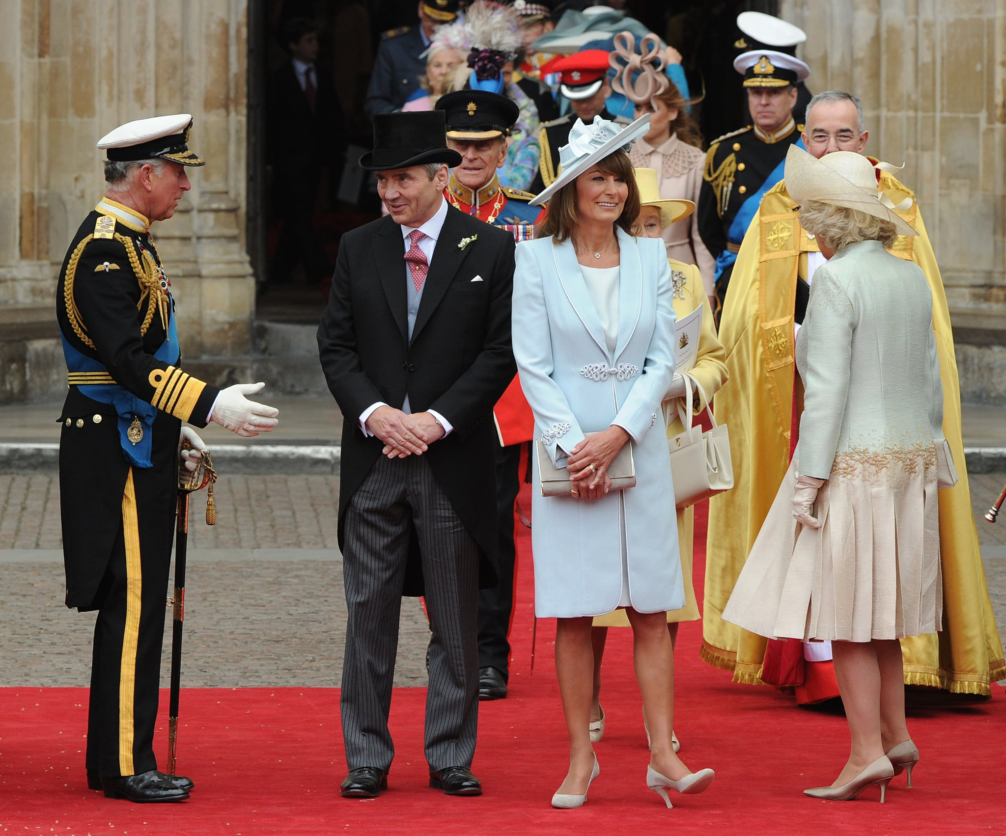 (From L to R) Britain's Prince Charles, Michael Middleton, Carole Middleton and Camilla, Duchess of Cornwall come out of Westminster Abbey in London, following the wedding ceremony of Prince William and Kate, Duchess of Cambridge, on April 29, 2011.  AFP PHOTO / CARL DE SOUZA (Photo credit should read CARL DE SOUZA/AFP/Getty Images)