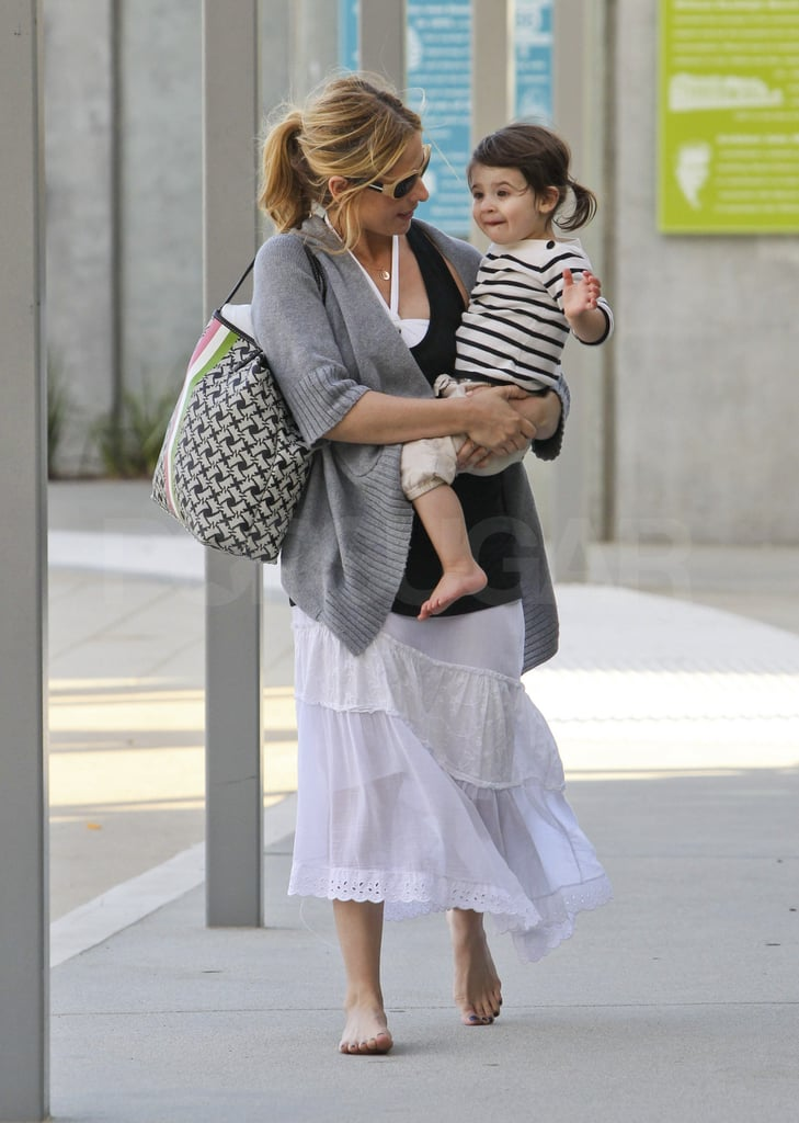 SMG and Charlotte Prinze parted ways with their friends and headed back to their car.