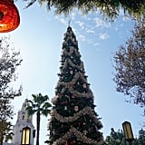 A 50-foot Christmas tree featuring vintage-style ornaments sits in the center of Carthay Circle.