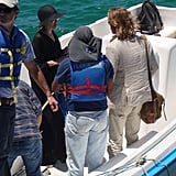 Angelina Jolie and Brad Pitt took a boat leaving the Galapagos Islands after a week-long family vacation there.