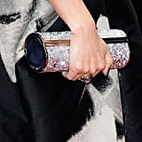 Zhang Ziyi carried a shimmering clutch.