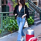 Selena styled a pair of frayed jeans with a chic Rouje top and white Louis Vuitton sneakers.
