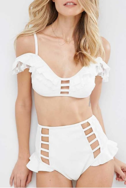 If you like your look to push the envelope, this ASOS design, featuring an off-the-shoulder frill top and cutout high-waisted bottoms (£44) definitely fits the bill! You'll need to be brave to pull it off, but it'll definitely get people talking.