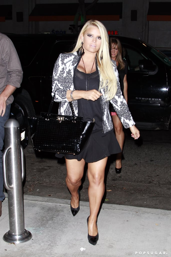 Jessica Simpson showed off her legs in a short black skirt.