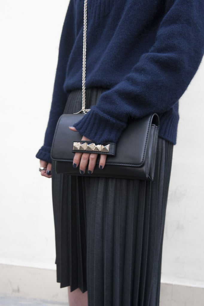 She finished a monotone look with a navy Valentino bag.