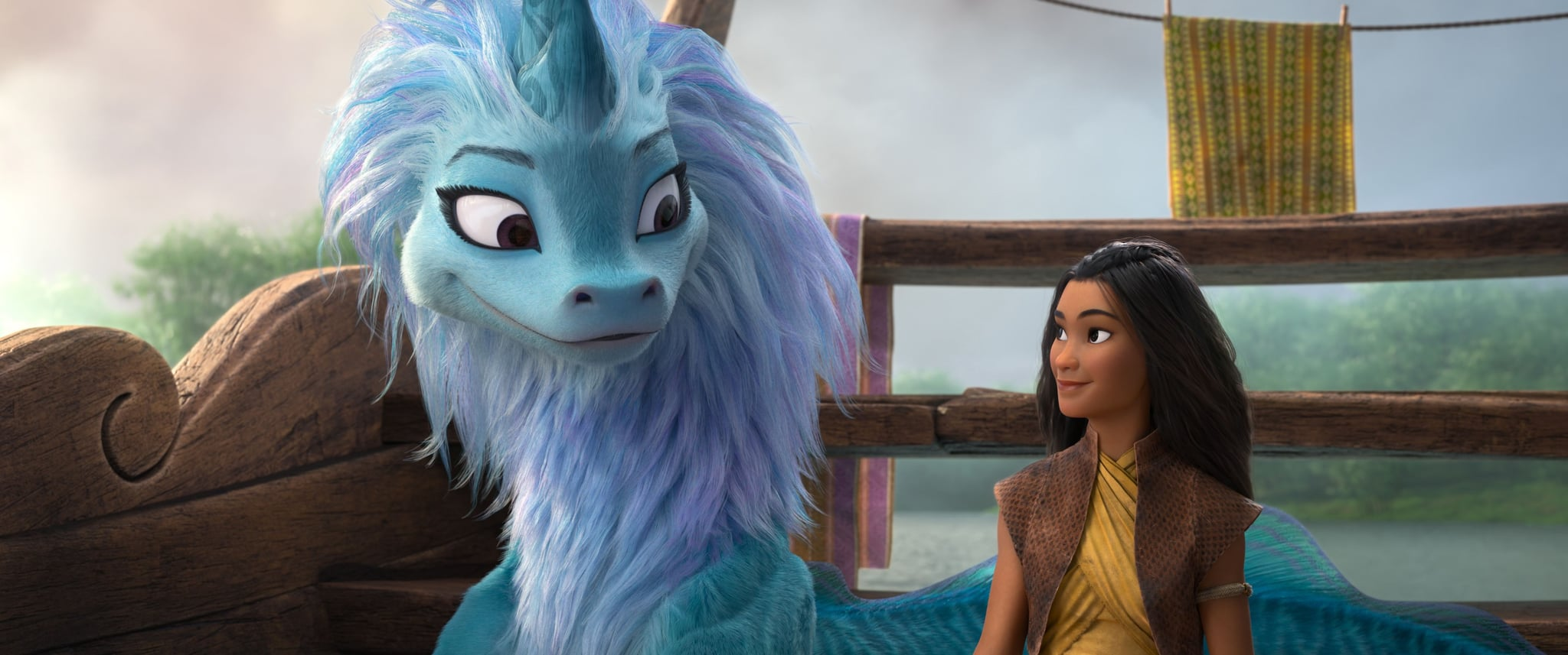 RAYA AND THE LAST DRAGON, from left: Sisu (voice: Awkwafina), Raya (voice: Kelly Marie Tran), 2021.  Walt Disney Studios Motion Pictures / Courtesy Everett Collection
