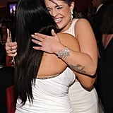 Kelly Osbourne hugged Kim Kardashian at Elton John's party on Oscar night.