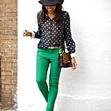 Karen is a guru when it comes to casual cool street style. Here, she pairs vibrant green jeans with a sheer top, leopard bag, and floppy hat.  Photo courtesy of WhereDidUGetThat