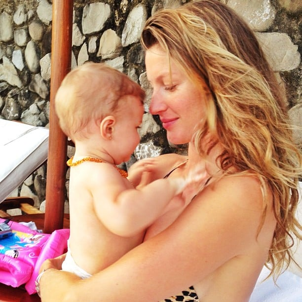 Gisele Bündchen snuggled up to her daughter Vivian in a bikini. Source: Instagram user giseleofficial